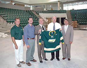 The Pathfinder Bank Oswego Hockey Classic will feature four of the best teams in NCAA Division III men's hockey at the Campus Center hockey arena this December. In the new arena as construction progresses are, from left, Oswego head coach Ed Gosek, Shane Broadwell of the Best Western Captain's Quarters and Econo Lodge Inn & Suites, Pathfinder Bank President and CEO Tom Schneider, Oswego Athletic Director Timothy G. Hale, and Oswego Blueline Club president Mike Cullinan. (courtesy Oswego Sports Information.)