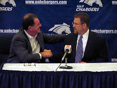 UAH athletics director Jim Harris congratulates Danton Cole at the press conference (photo: Jamie Gilliam, UAH Sports Information).
