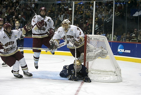 BC goalie John Muse goes airborne in the title game against Notre Dame (photo: Jim Rosvold.)