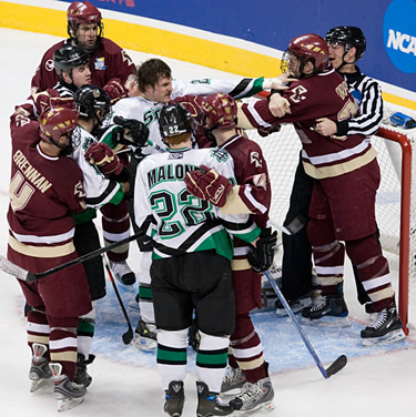 Boston College's Mike Brennan, left, grabs a North Dakota sweater as tempers flare in the second period (photo: Melissa Wade.)