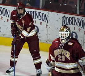 Chris Butler (left, alongside Peter Mannino) in a familiar position -- taking care of defense (photo: Candace Horgan).