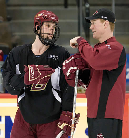 Boston College captain Mike Brennan talks with assistant coach Greg Brown at Friday's practice (photo: Melissa Wade.)
