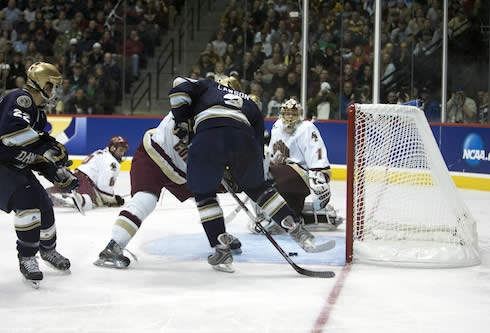 A puck off the skate of Notre Dame's Kyle Lawson eventually turned into a no-goal for the Irish (photo: Jim Rosvold).