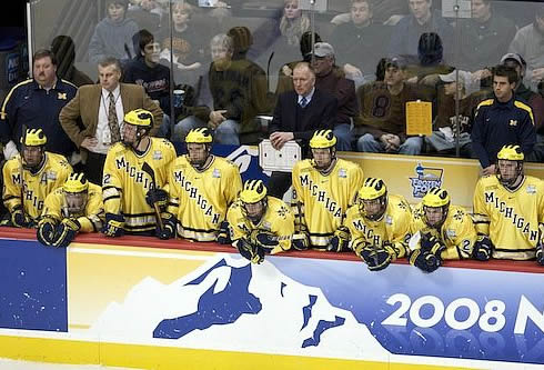 Michigan's bench looks dejected in the first period of Thursday's semifinal after Notre Dame took an early 2-0 lead (photo: Jim Rosvold.)