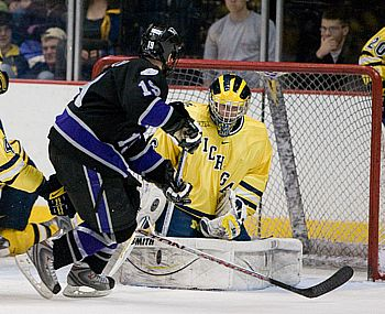 Billy Sauer (here in net against Niagara's Matt Caruana) has made a difference for Michigan this season (photo: Melissa Wade).