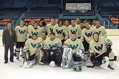 Wayne State hockey gathers on the ice after Saturday's contest.