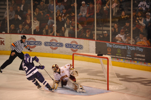 Marc Cheverie stops Jay Silvia's shot to win the shootout for Denver. Photo by: Candace Horgan