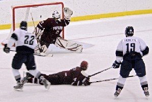 Geneseo's senior forward Kevin Galan scores the second of his two goals against Potsdam. Photo: Angelo Lisuzzo.