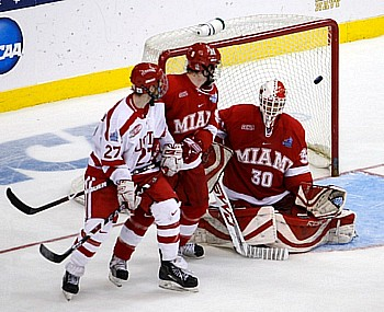 Colby Cohen's winning goal floats over the shoulder of Cody Reichard to give Boston University the title (photo: Jim Rosvold).