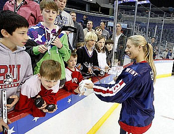 Melanie Gagnon of Minnesota signs autographs for some of the young fans at the Skills Challenge (photo: Jim Rosvold).