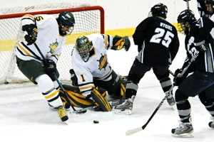 Oswego's Tim Potter making one of his 27 saves against Geneseo (photo: Angelo Lisuzzo).