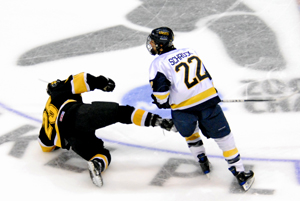 Lincoln Schrock (22) lays a check on a Gustavus player (photo: Angelo Lisuzzo).