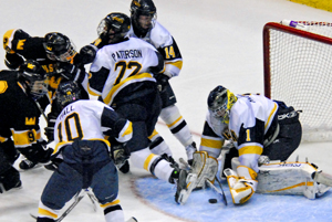 Ross MacKinnon makes one of his 24 saves for the win  (photo: Angelo Lisuzzo).
