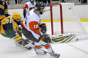 RIT's Jess Newman (10) beats Paul Karpowich to give the Tigers a 2-0 first period lead (photos: Angelo Lisuzzo).
