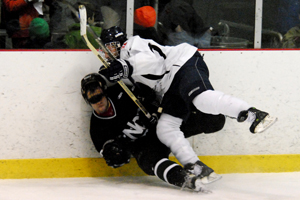 Hobart sophomore Tom Capalbo crunches a Nichols player along the boards (photo: Angelo Lisuzzo).