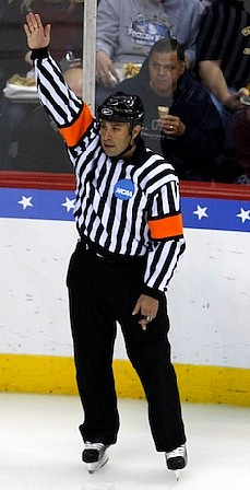 Referee Marco Hunt raised his arm repeatedly Saturday night, but to little effect on the scoreboard (photo: Jim Rosvold).