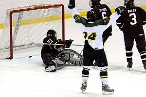 Brockport's Andrew Simmons (24) celebrates one of his team's three goals against Potsdam.