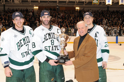 With the McLeod Trophy are (l-r) Cody Bostock, Travis Winter, former CHA commissioner Bob Peters and Chris McKelvie (photos: BSU photo services).