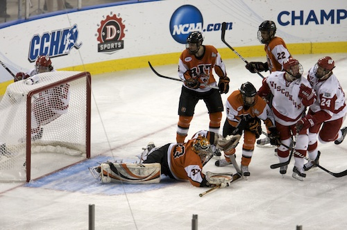 John Mitchell (24) scores Wisconsin's first goal just 1:27 into the game (photo: Jim Rosvold).