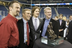 Wisconsin assistant coach Mark Osiecki, coach Mike Eaves, Blake Geoffrion and assistant coach Kevin Patrick pose with the Hobey Baker Award (photo: Jim Rosvold).