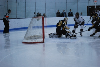 Gustavus's Josh Swartout's excellent play in net this year has brought the Gusties back to the MIAC title game (photo: Scott Bridges).