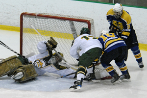 Brockport's Todd Sheridan dives for one of his 33 saves (photo: Angelo Lisuzzo).