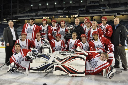 The West piles around the trophy for winning the Frozen Four Skills Challenge (photo: Candace Horgan).