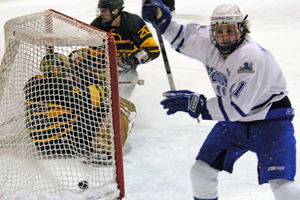 James Muscatello scores against Brockport. Photo by Angelo Lisuzzo.