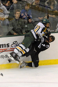 Oswego and Bowdoin got physical early in the game (photo: Angelo Lisuzzo).