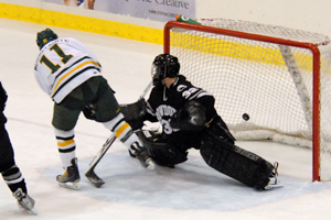 Oswego's Neil Musselwhite scores a spectacular score to tie the game at one (photo: Angelo Lisuzzo).