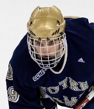 Notre Dame's Ben Ryan and every other college hockey player have to wear full facial protection under NCAA rules, but some say wearing visors could actually help protect players (photo: Melissa Wade).