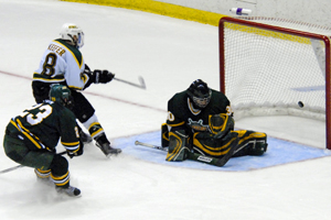 Cody Keefer scores the winning goal for St. Norbert with 39.4 seconds left. Photo by Angelo Lisuzzo.