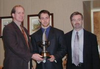 Colgate's Andy McDonald (center) accepts his award as ECAC Player of the Year.