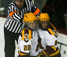 Amanda Kessel (22) and Hannah Brandt (8) celebrate Kessel's second goal of the evening and 36th of the year in the Gophers' 5-0 rout of Minnesota-Duluth on February 1, 2013 at Ridder Arena....Unauthorized reproduction of d3photography.com photos is strictly forbidden (resale, reproduction);.use in advertising (for profit or at a loss) is a violation of the Student-Athlete's eligibility to compete...NCAA Bylaw 12.5.2.2 - Use of a Student-Athlete's Name or Picture Without Knowledge or Permission..If a student-athlete's name or picture appears on commercial items (e.g., T-shirts, sweatshirts, serving trays, playing cards, posters) or is used to promote a commercial product sold by an individual or agency without the student-athlete's knowledge or permission, the student-athlete (or the institution acting on behalf of the student-athlete) is required to take steps to stop such an activity in order to retain his or her eligibility for intercollegiate athletics. Such steps are not required in cases in which a student-athlete's photograph is sold by an individual or agency (e.g., private photographer, news agency) for private use. (Revised: 1/11/97, 5/12/05) (Ryan Coleman/Ryan Coleman, d3photography.com)