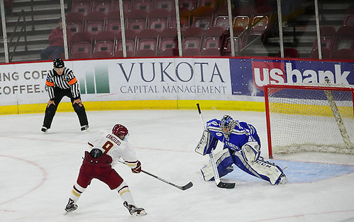 Austin Cangelosi of Boston College scores on a penalty shot, Air Force vs. Boston College 10-7-16, Icebreaker Tournament, Magness Arena, Denver, Colorado. (Candace Horgan)