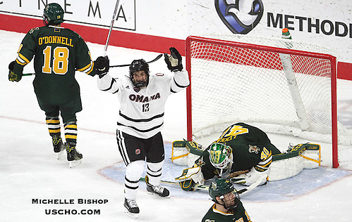 Omaha's Jake Randolph (13) celebrates Luc Snuggerud's goal during the second period. Omaha and Vermont skated to a 4-4 tie Friday night at Baxter Arena.  (Photo by Michelle Bishop) (Michelle Bishop)