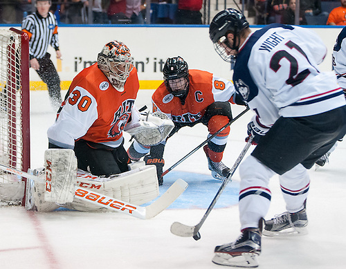 Jeff Wight (21 - UConn) tries to get a shot off on Mike Rotolo (30 - RIT) (Omar Phillips)