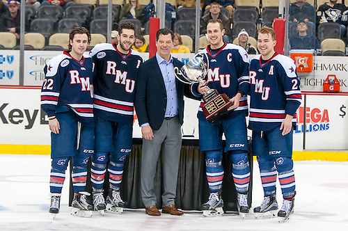 Robert Morris captains are presented with their second straight Three Rivers Classic trophy (Omar Phillips)