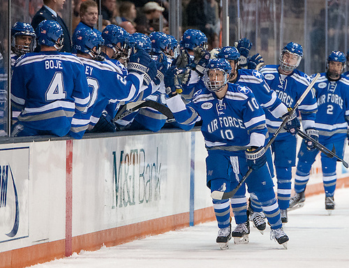Air Force players celebrate a second period goal in a 3-2 win at RIT (Omar Phillips)
