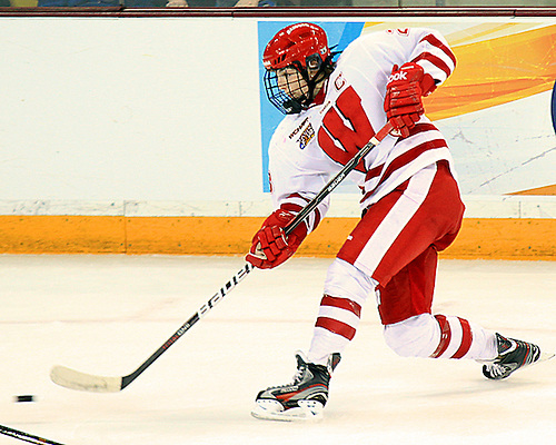 Wisconsin's Hilary Knight fires a slapshot during the NCAA Frozen Four Championship Game in Duluth Sunday afternoon. (2012 Dave Harwig)
