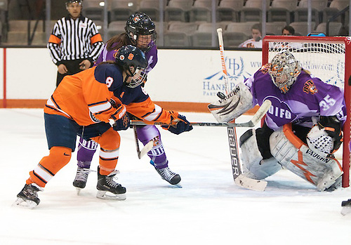 Jetta Rackleff (35 - RIT) makes one of her 41 saves in front of Stephanie Grossi (8 - Syracuse) and Carly Payerl (17 - RIT) (Omar Phillips)