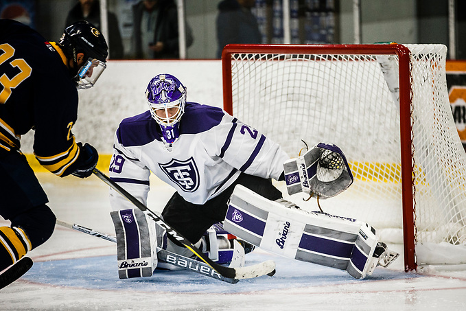 Benjamin Myers makes a save during a men's ice hockey game against the University of Wisconsin-Eau Claire on November 9, 2017, in the St. Thomas Ice Arena in Mendota Heights. UST won the game by a final score of 5-3. (Mark Brown/University of St. Thomas)