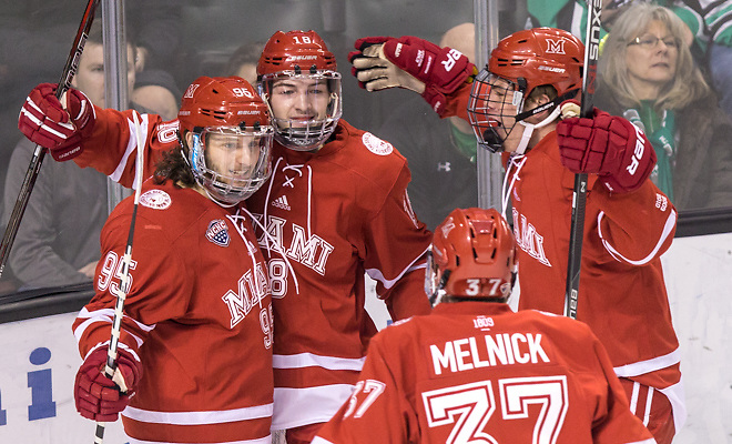 Anthony Louis (Miami of Ohio-95) Carson Meyer (Miami of Ohio-18) Josh Melnick (Miami of Ohio-37) 17 Jan.14 Miami of Ohio Redhawks and University of North Dakota meet in a NCHC conference match-up at the Engelsted Arena Grand Forks, ND (Bradley K. Olson)