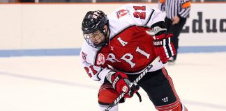 Chase Polacek (RPI - 21) carries the puck through the neutral zone. The Rennselaer Engineers visited Princeton
