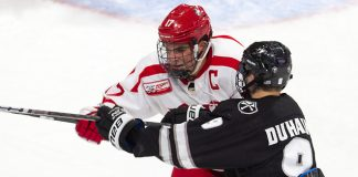 Dante Fabbro (BU - 17), Brandon Duhaime (PC - 9) - The visiting Providence College Friars defeated the Boston University Terriers 5-0 on Friday, October 26, 2018, at Agganis Arena in Boston, Massachusetts. - The visiting Providence College Friars defeated the Boston University Terriers 5-0 on Friday, October 26, 2018, at Agganis Arena in Boston, Massachusetts. (Melissa Wade)