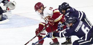 Will MacKinnon (UNH - 5), Oliver Wahlstrom (BC - 18), Angus Crookshank (UNH - 6) - The Boston College Eagles tied the visiting University of New Hampshire Wildcats 2-2 on Friday, November 16, 2018, at Kelley Rink in Conte Forum in Chestnut Hill, Massachusetts. (Melissa Wade)