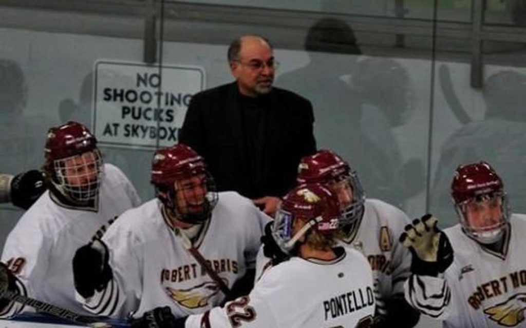 Minnesota investigating allegations of abuse by former hockey assistant coach Adrahtas